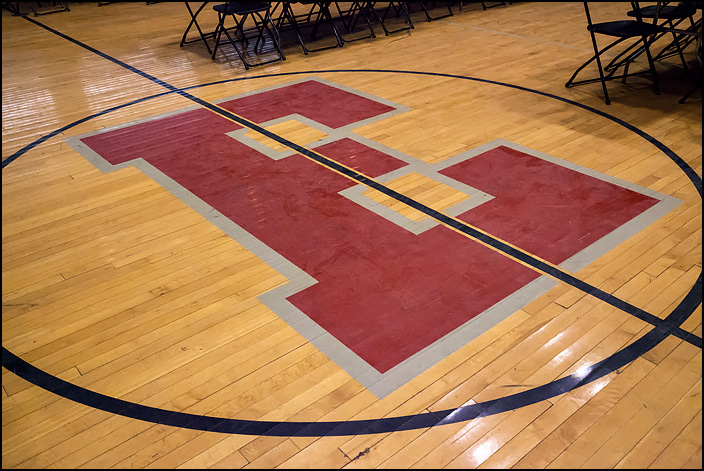 The big red letter E in the center of the basketball floor in the main gym at Elmhurst High School in Fort Wayne, Indiana.