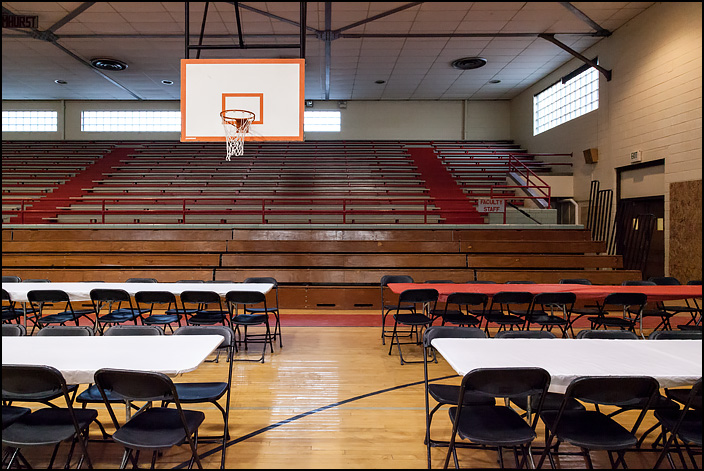 Tables and chairs fill the basketball court in the main gym at Elmhurst High School in Fort Wayne, Indiana. They were there for the final walk-through tour of the old school for alumni before its demolition.