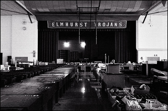 The main gymnasium of Elmhurst High School in Fort Wayne is full of desks and school equipment for auction two years after the school closed.
