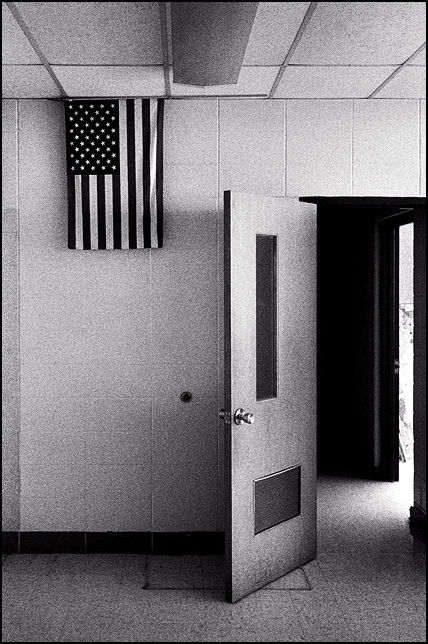 An American flag hangs by the door of an empty classroom in the abandoned Elmhurst High School in Fort Wayne.
