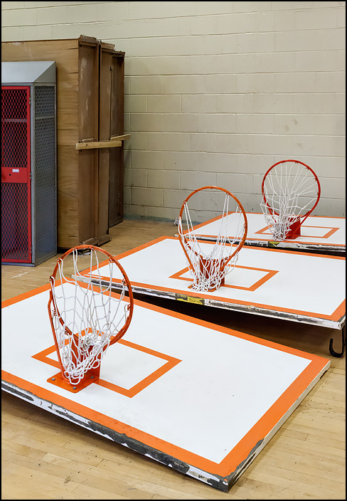 Three basketball backboards and hoops from the gym lay on the floor at the pre-demolition sale held at Elmhurst High School on January 27, 2018.
