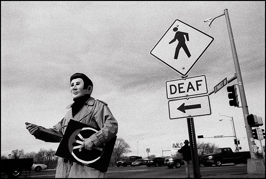 An antiwar demonstrator dressed as Elvis Presley holds his peace sign like a guitar during the weekly demonstration in Santa Fe, New Mexico.