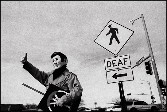 A peace activist dressed as Elvis Presley gives the Thumbs Up during the weekly antiwar demonstration in Santa Fe, New Mexico.