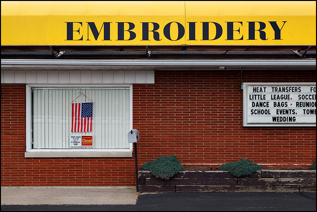 An American flag in the front window of A to Z Embroidery in the Waynedale area of Fort Wayne, Indiana.