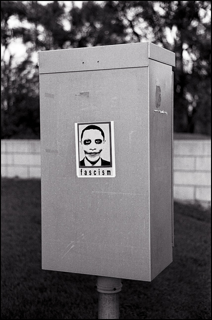 A sign that depicts President Obama as the Joker with him labeled as a Fascist is posted on a traffic signal box in Fort Wayne, Indiana.