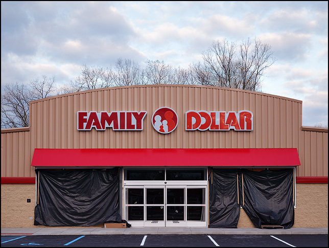 A new Family Dollar store under construction on Bluffton Road in Fort Wayne, Indiana. The sign has been installed on the front of the building and the parking lot is paved.