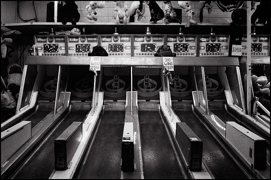 Ski Ball game at a carnival in the dark of night.