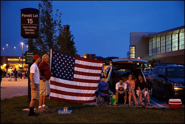 A large American flag displayed by a family tailgating at the 2013 Fourth of July fireworks at IPFW in Fort Wayne, Indiana.