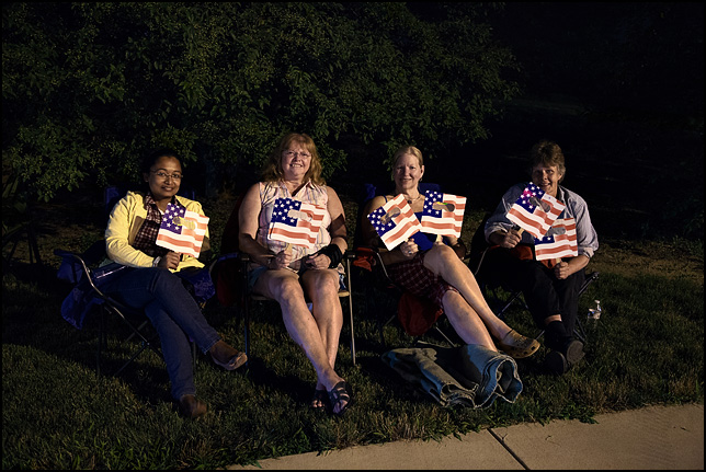 Four women using Fireworks Glasses printed with the American flag to watch the 2013 Fourth of July fireworks at IPFW in Fort Wayne, Indiana.