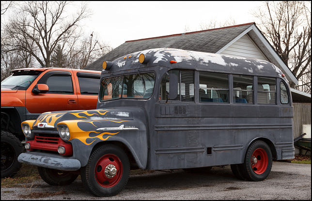 1958 Chevrolet Apache School Bus With Hot Rod Flames Painted On It