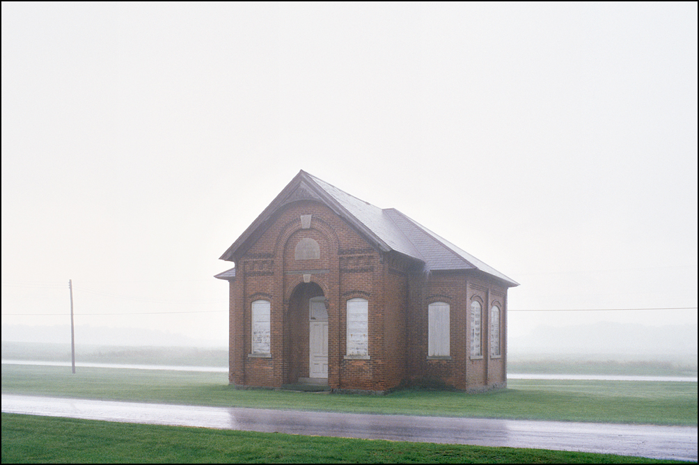 The Jefferson Township #5 Center School in the rain during a summer thunderstorm in Besancon, Indiana.