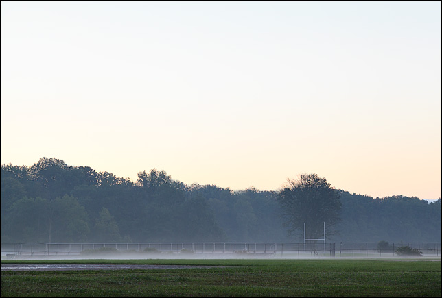 Early morning fog on the football field at a middle school in Fort Wayne, Indiana.