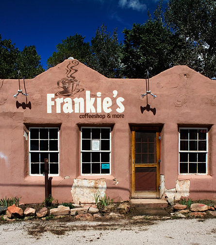 Frankies Coffeeshop is an abandoned restaurant in Pecos, New Mexico. The building is adobe and has a cup of steaming coffee painted on the facade above the windows.