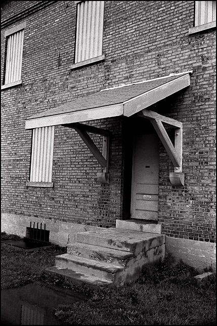 The boarded up windows and door on the entrance to the old brick New York Central Railroad Freight House on Clinton Street in Fort Wayne.