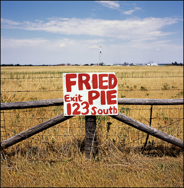A hand-painted sign nailed to a fence post advertises fried pie at Exit 123 on Interstate 44 in Oklahoma near the town of Hydro.