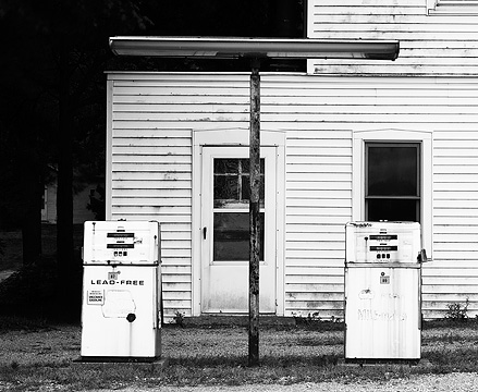 Abandoned Marathon gas station with old pumps and lights on US-35 near Logansport, Indiana.