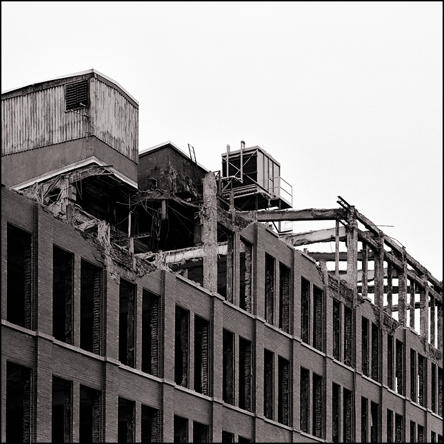 The top floor an office building has been demolished at the abandoned General Electric factory on Broadway in Fort Wayne, Indiana.