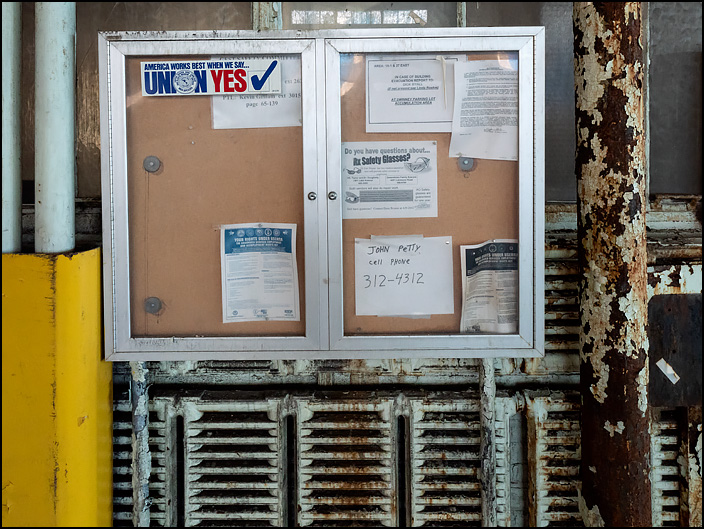 A display case with union signs hangs on the wall above the heating radiators in one of the buildings in the abandoned General Electric factory complex on Broadway in Fort Wayne, Indiana.