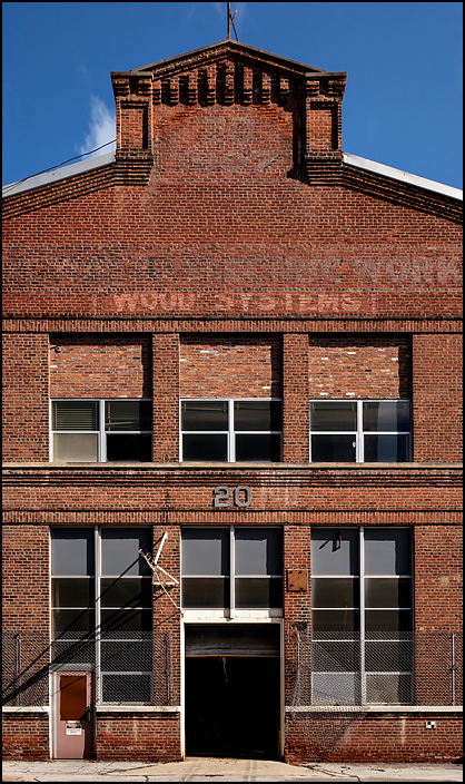 Building 20 is one of the oldest buildings at the abandoned General Electric factory complex on Broadway in Fort Wayne, Indiana. The faded sign painted on the brick facade says, Fort Wayne Electric Works.
