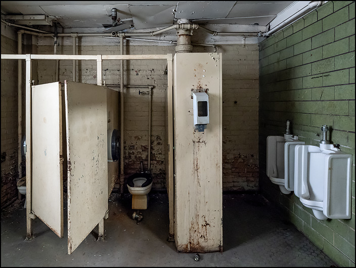 Mens restroom in Building 22 at the abandoned General Electric factory complex on Broadway in Fort Wayne, Indiana.