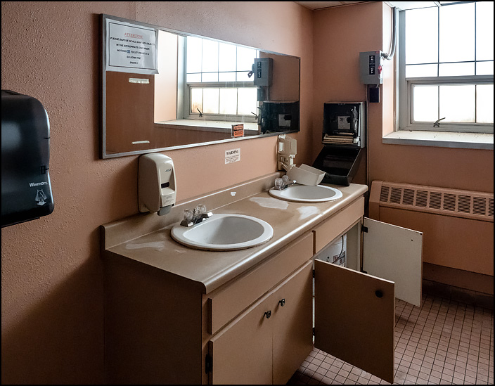 A womens restroom in Building 26 at the former General Electric factory complex on Broadway in Fort Wayne, Indiana. The towel and soap dispensers are broken open, but the rest of the room is in nice condition.