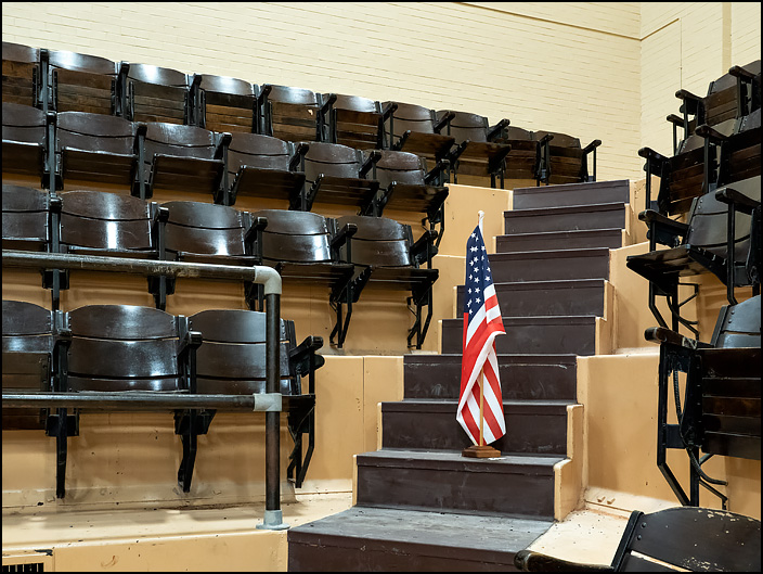 A small American flag stands among the seats in the gymnasium of the GE Club at the former General Electric factory complex in Fort Wayne, Indiana.