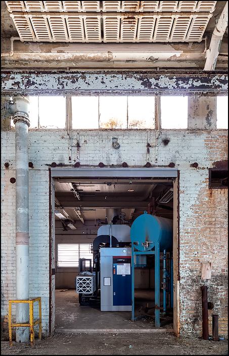 A generator and fuel tank in a side room on the first floor of building 19 at the former General Electric factory complex in Fort Wayne, Indiana.