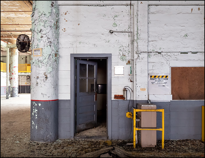 The door to an office on the first floor of building 19 at the former General Electric factory complex in Fort Wayne, Indiana. A sign on the wall says it is a Right To Know Center, where MSDS are kept. A drinking fountain stands by the door.