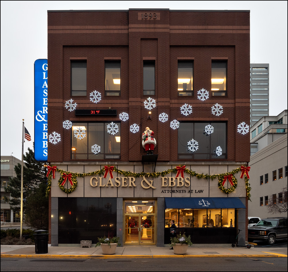 The Glaser and Ebbs building on Berry Street in downtown Fort Wayne, Indiana. The former bank building is decorated for Christmas with lighted snowflakes and a statue of Santa Claus.