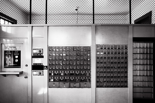 Black and white photograph of the interior of the small post office in the village of Glorieta, New Mexico.