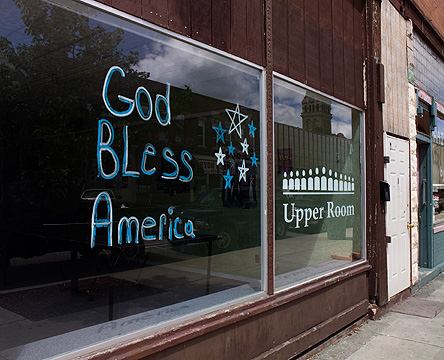 God Bless America painted on a storefront window in the small town of Knox, Indiana.