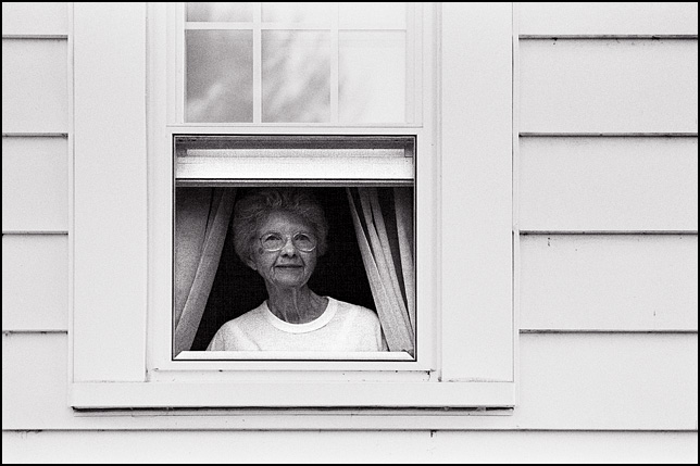 My grandmother, Stella Westerfield, looking out through a window on the side of her house in Fort Wayne.