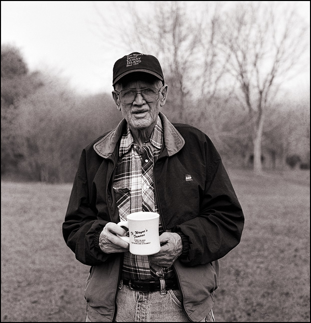 My grandfather, Charles Crawford, showing off the baseball cap and coffee cup that he got from Fort Wayne's Famous Coney Island Hot Dog Stand.