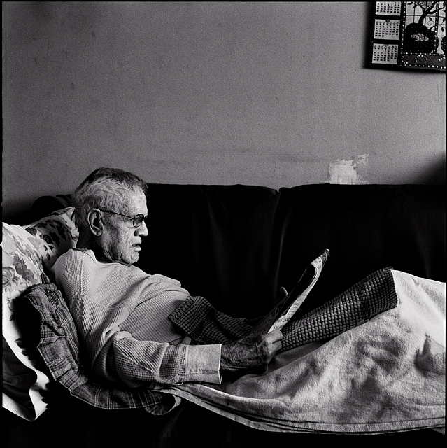 My grandfather, Charles Crawford, laying on his sofa reading the newspaper. Grandpa has Alzheimer's disease.
