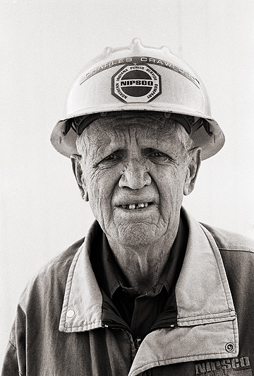 Retired pipe-fitter Charles Crawford wearing his old NIPSCO gas company hardhat.