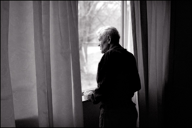 My grandfather, Charles Crawford, looking out the window of his home.