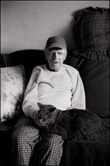 My grandfather, Charles Crawford, in the late stages of Alzheimer's disease, petting his old cat.