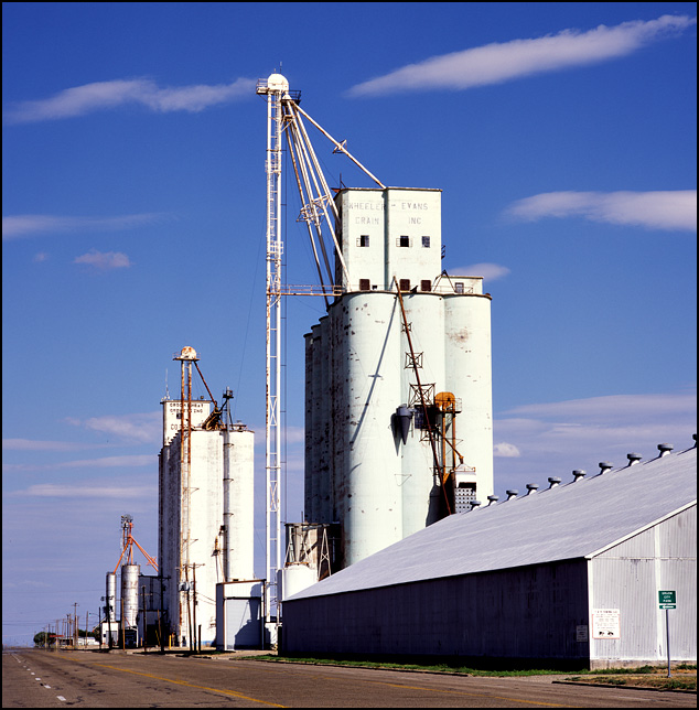 The Groom Wheat Growers Co-Op and the Wheeler-Evans Grain Incorporated grain elevators along old Route 66 in the small town of Groom, Texas.