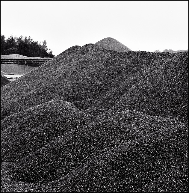 Large piles of crushed limestone aggregate at the Hanson quarry on Ardmore Avenue in Fort Wayne, Indiana.