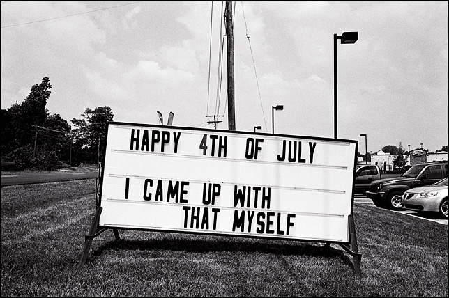 "A roadside sign that says ""Happy 4th of July. I came up with that myself."" The sign was in front of a shopping center on West Jefferson Boulevard in Fort Wayne, Indiana."