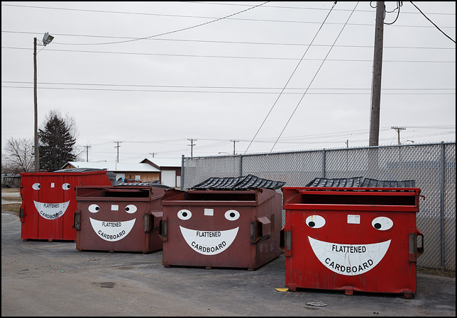 Recycle bins with smiling faces painted on them in the small town of Ligonier, Indiana.