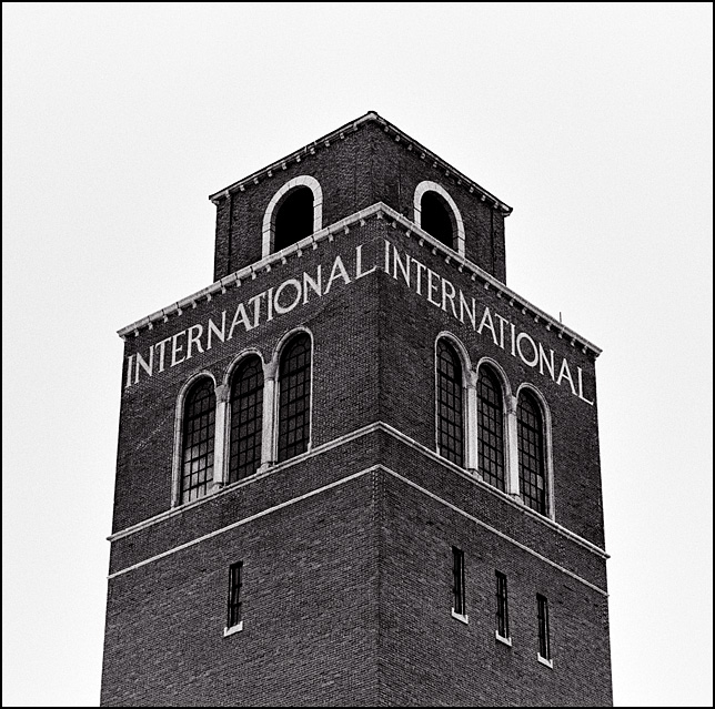 The International name is spelled out in stone near the top of the brick Romanesque style water tower in front of the abandoned International Harvester factory in Fort Wayne, Indiana.