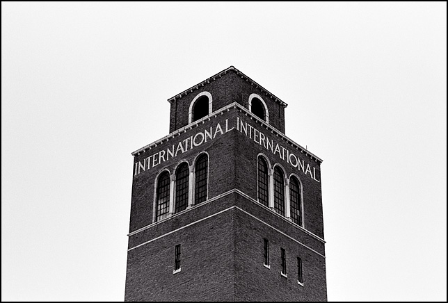 The top of the Italianate brick water tower in front of the old International Harvester plant in Fort Wayne, Indiana.