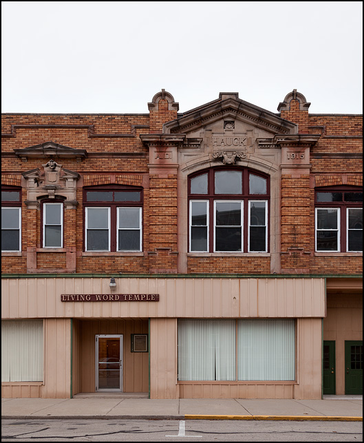 The Haugk Building is a historic brick commercial building on Madison Street in the small town of Decatur, Indiana. The first floor is a storefront church, Living Word Temple.