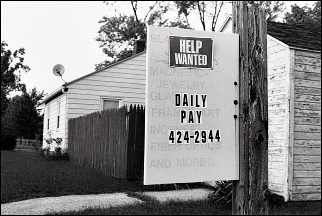 A sign that says Help Wanted Daily Pay.