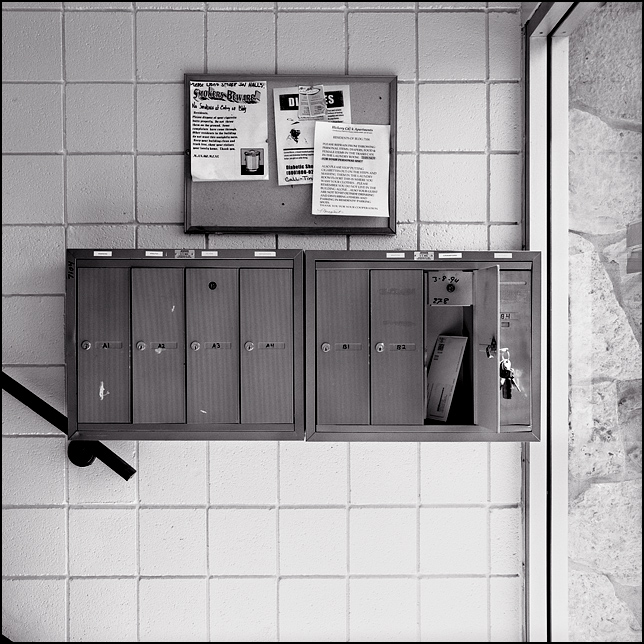 Mailboxes in an apartment building in Waynedale | Photograph by ...