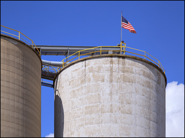 An American flag flies from the top of a huge concrete silo at Hicksville Grain in the small town of Hicksville, Ohio.