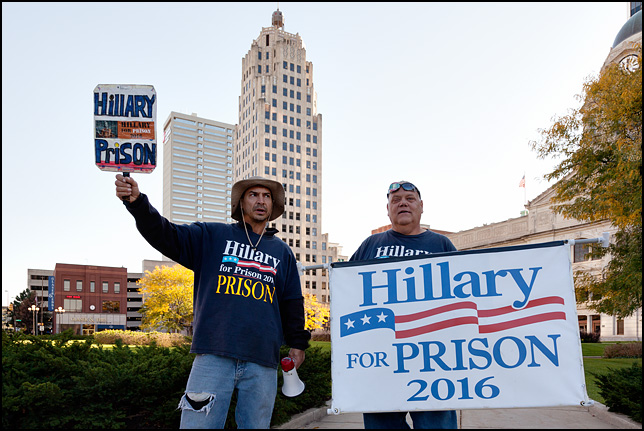 Donald Trump supporter Dan Carroll and another man holding a large Hillary For Prison 2016 sign in front of the Allen County Courthouse in Fort Wayne, Indiana.