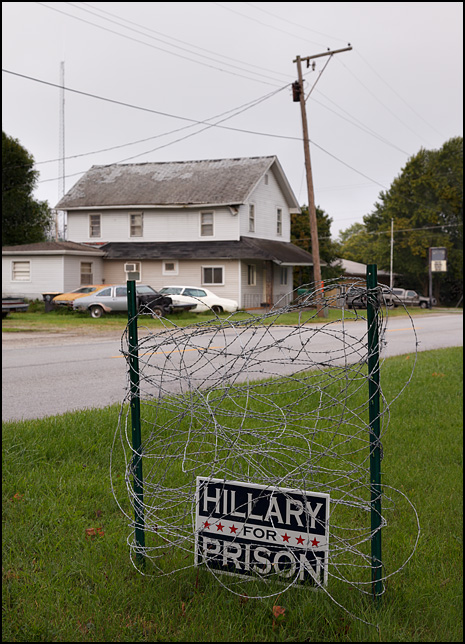 A Hillary For Prison sign surrounded by barbed wire on Winchester Road in the small town of Poe, Indiana.