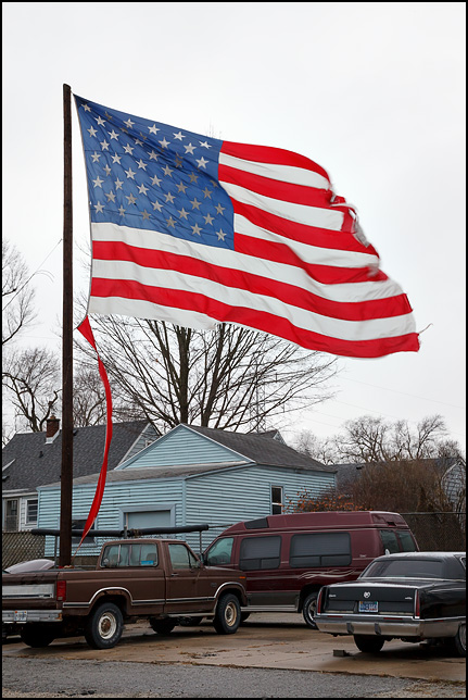 An enormous American flag flies over the lot at a construction company in Fort Wayne, Indiana.